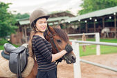 Jockey girl and her horse — Stock Photo