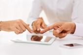Pointing at  digital tablet — Stock Photo