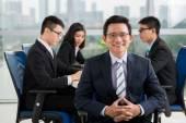 Mature Asian businessman — Stock Photo