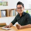 Happy man at his workplace — Stock Photo #61044627