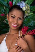 Filipina with red ginger flower — Stock Photo