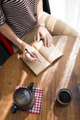 Writing in journal — Stock Photo