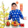 Man showing food on the holiday table — Stock Photo #63671143