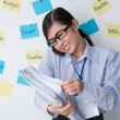 Manager with stack of documents talking on phone — Stock Photo #63670651
