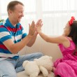 Father and daughter playing patty cake — Stock Photo #63670887