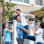 Family celebrating after buying house — Stock Photo #63672665