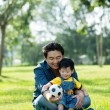 Father Giving son soccer ball — Stock fotografie #63672771