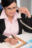 Businesswoman making notes — Stock Photo