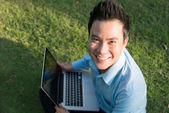 Manager with laptop working in the park — Stock Photo