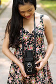 Woman with vintage photo camera — Stock Photo