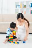 Boy and mother playing with constructor — Stock Photo