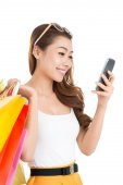 Lady with paper bags texting — Stock Photo