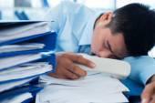 Businessman fell asleep with a telephone — Stock Photo