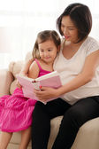 Mother reading a book to daughter — Stock Photo