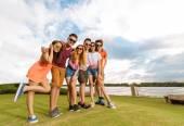 Joyful young people in sunglasses — Стоковое фото