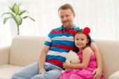 Family of two sitting on the sofa — Stock Photo