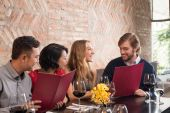 Couples reading menu in a restaurant — Stock Photo