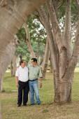 Senior men talking while walking — Stock Photo