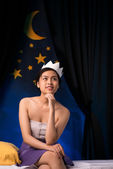 Dreamy Asian girl in paper crown — Stock Photo