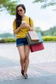 Girl with shopping bags and coffee — Stock Photo