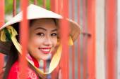 Vietnamese girl in conical hat — Stock Photo