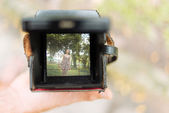 Camera with photo of young girl — Stock Photo