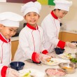 Kids having cooking lesson — Stock Photo #67315867