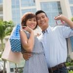Vietnamese couple of shopaholics — Stock Photo #67316009