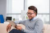 Reading something on the digital tablet — Stock Photo