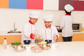 Kids  cooking in the kitchen — Stock Photo