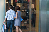 Couple looking at the shop window — Stock Photo