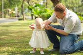 Baby  making first steps — Stock Photo