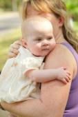 Mother holding her baby — Stock Photo