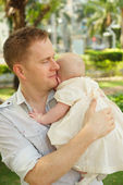 Father carrying his infant daughter — Stock Photo
