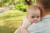 Baby looking over shoulder of her father — Stock Photo
