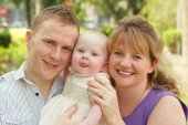 Little girl with her parents — Stock Photo