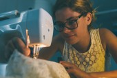 Young dressmaker sewing — Stock Photo
