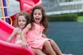 Little  girls on the slide — Stock Photo