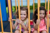 Little sisters on the playground — Stock Photo