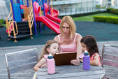 Mother and her  daughters using  tablet — Stock Photo