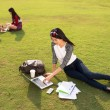 Student doing homework outdoors — Stock Photo #69304733