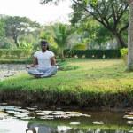 Man practicing yoga — Stock Photo #69308753