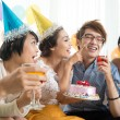 Friends having fun with cake — Stock Photo #69309035