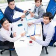 Colleagues discussing financial documents — Stock Photo #69309485