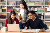 Students studying in the library — Stock Photo