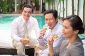 Colleagues having drink after work — Stock Photo
