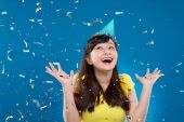 Girl under falling confetti — Stock Photo