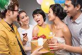 Friends presenting a gift to a girl — Stock Photo