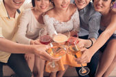 People clinking glasses with cocktail — Stock Photo