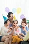 Girl enjoying her birthday cake — Stock Photo